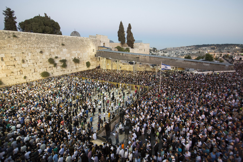 Click photo to download. Caption: On June 15, thousands gather at the Western Wall to pray for the release of three Jewish teenagers who have been missing since the night of June 12. Israeli Prime Minister Netanyahu has said that Hamas terrorists kidnapped the teens. Credit: Yonatan Sindel/Flash90.