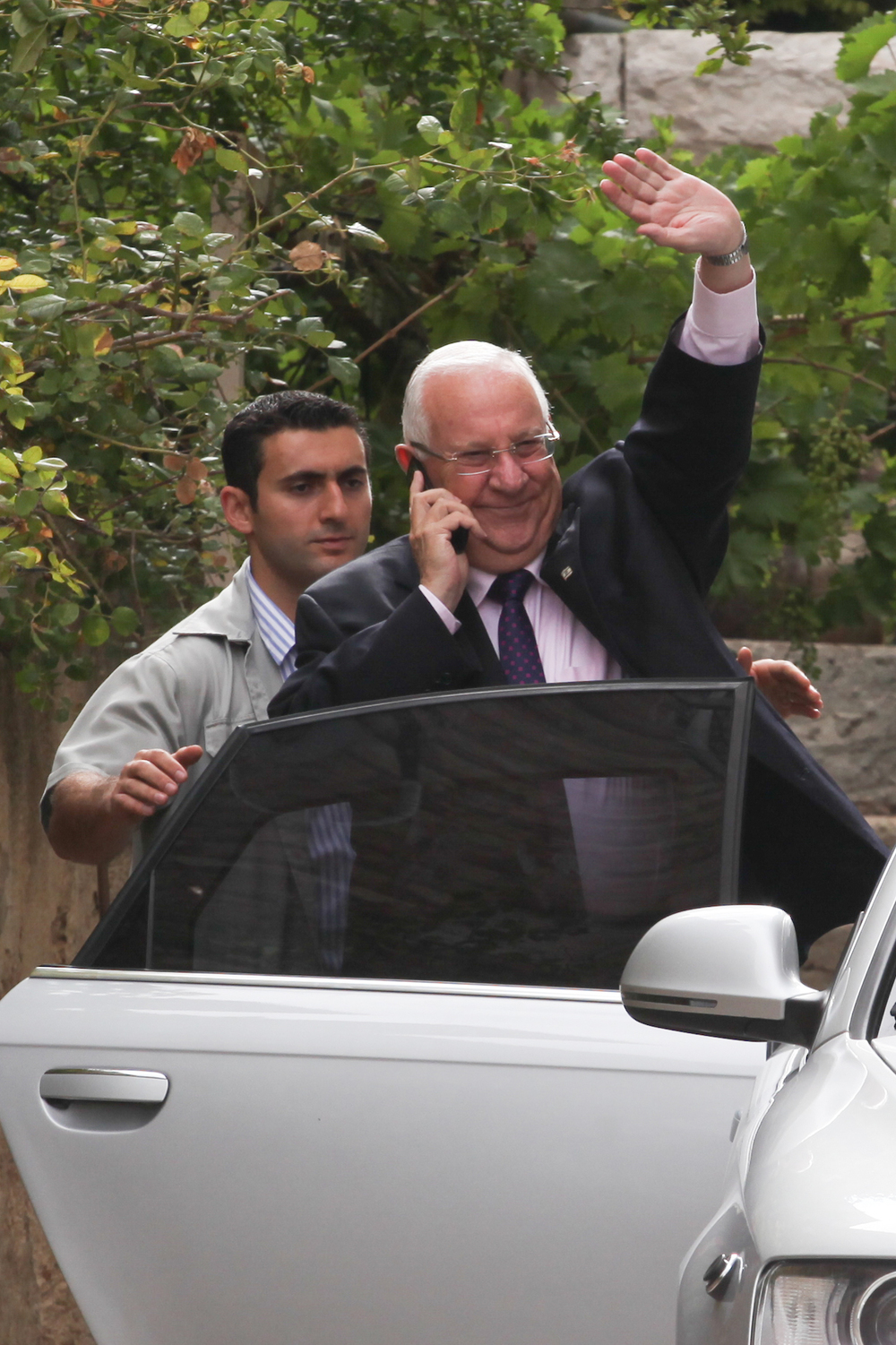 Click photo to download. Caption: Israeli president-elect Reuven Rivlin seen leaving his home in Jerusalem on June 11, a day after winning a vote for president held in the Israeli Knesset. Credit: Flash90.