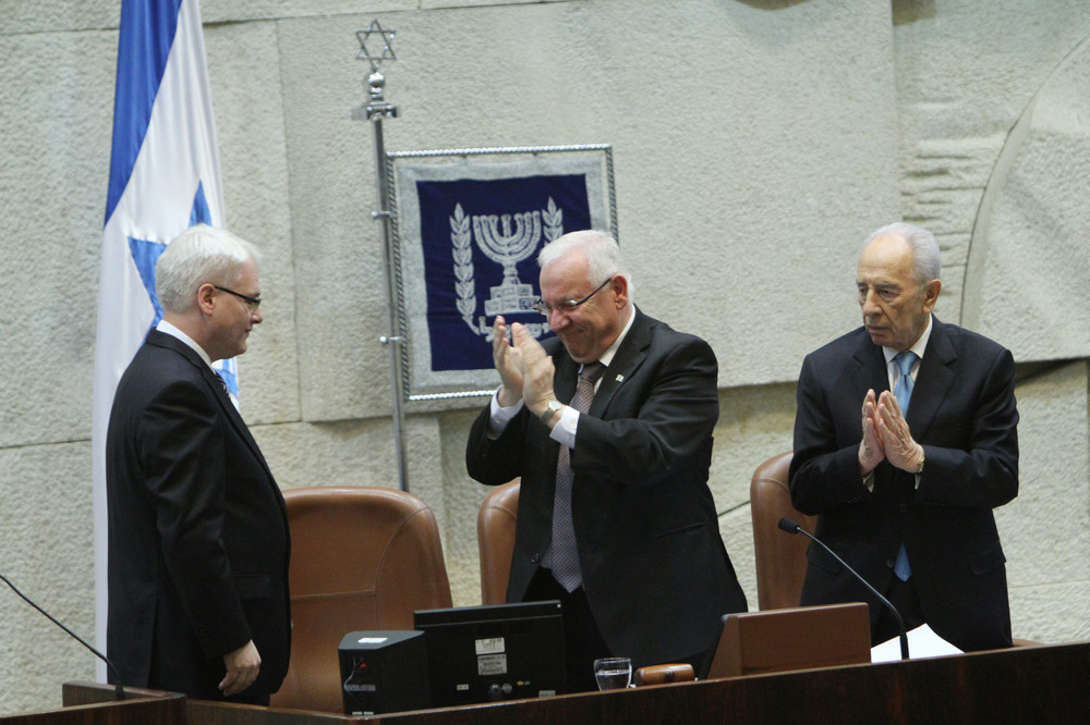 Click photo to download. Caption: Reuven Rivlin (center), then speaker of the Knesset, and Israeli President Shimon Peres applaud after listening to the speech of Croatian President Ivo Josipovic (left) in the Israeli parliament on February 15, 2012. Rivlin will succeed Peres as president next month. Credit: Miriam Alster/Flash90.