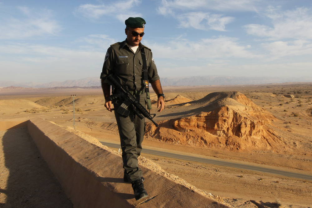 Click photo to download. Caption: An Israeli border policeman patrols the area of the Judean desert, near the Jordan border. After swift victories in Iraq, the Islamic State in Iraq and Greater Syria (ISIS) terrorist group is also setting its sights on Jordan, threatening to drag Israel into the global jihadist conflict. Credit: Nati Shohat/Flash90.