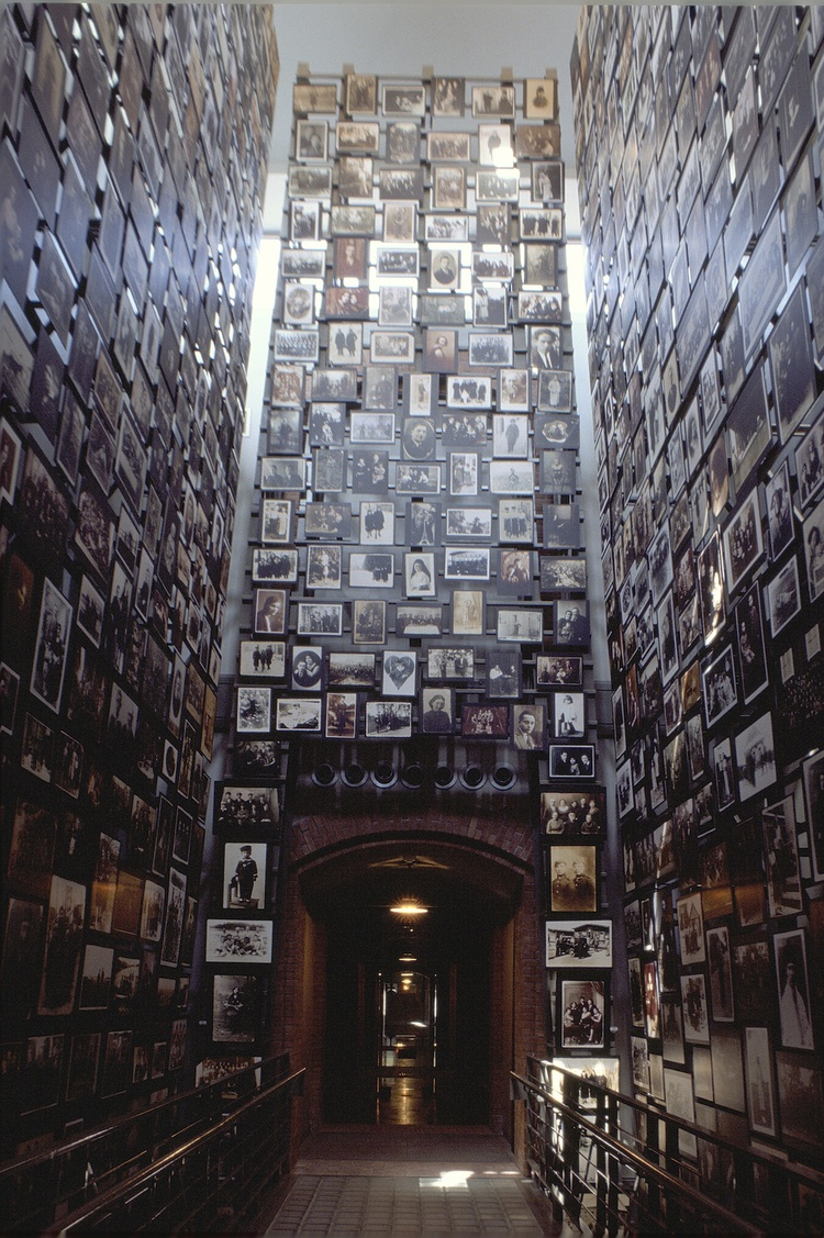 Click photo to download. Caption: The three-story Tower of Faces at the U.S. Holocaust museum displays photographs from the Yaffa Eliach Shtetl Collection. Taken between 1890 and 1941 in Eishishok, a small town in what is now Lithuania, they describe a vibrant Jewish community that existed for 900 years. In 1941, an SS mobile killing squad entered the village and within two days massacred the Jewish population. Credit: United States Holocaust Memorial Museum.