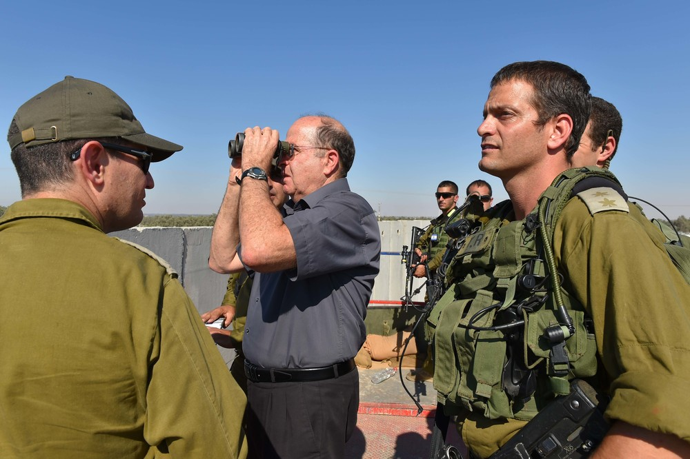 Click photo to download. Caption: Israeli Defense Minister Moshe Ya'alon (with binoculars) pictured during a visit to the Israel Defense Forces (IDF) Southern Command's Gaza Division on Tuesday. The IDF launched Operation Protective Edge in Gaza in response to escalated rocket fire by Hamas. Credit: Ariel Hermoni/Ministry of Defense/Flash90.