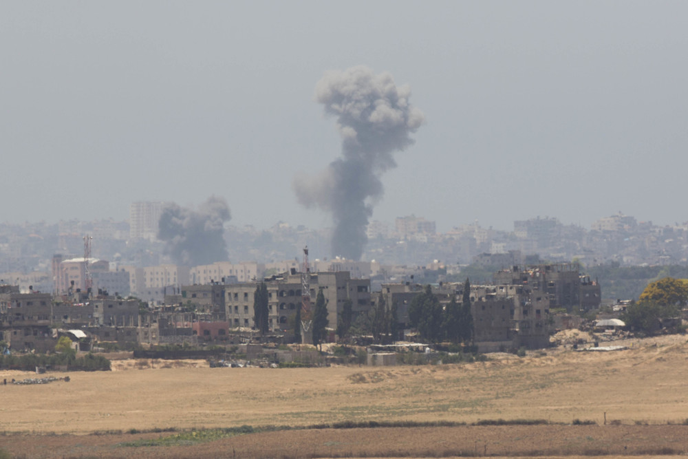 Click photo to download. Caption: Smoke rises in Gaza after an Israeli airstrike on the second day of Operation Protective Edge, July 9, 2014. Credit: Yonatan Sindel/Flash90.