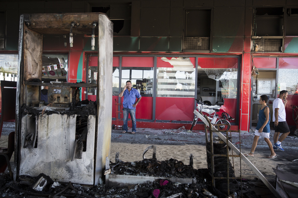 Click photo to download. The scene of a gas station in Ashdod that was hit directly by rocket fire from Gaza on the fourth day of Operation Protective Edge, July 11, 2014. The rocket caused explosions and three people were injured, one of them critically. Credit: Hadas Parush/Flash90.