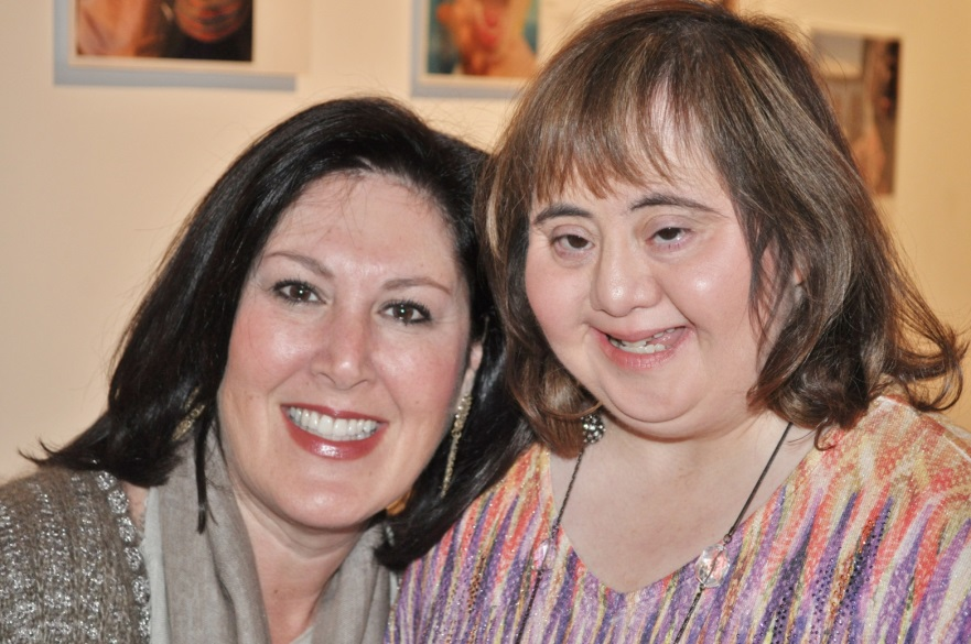"Jewish Family Services (JFS) of Houston President Debra Cohen (left) and Becky Cisneros at the family reception for ""Houstonians with Positive Exposure,"" which featured photos of local individuals with genetic differences and disabilities at the Nicole Longnecker Gallery in February 2014. The Houston JFS on Monday was named one of five recipients of the third annual Ruderman Prize in Inclusion. Credit: Meredith Segal."