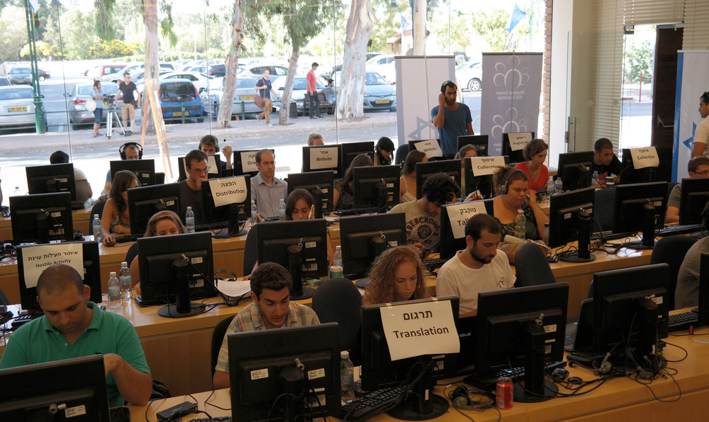 "Click photo to download. Caption: Student volunteers work together from a computer room at the Interdisciplinary Center Herzliya (IDC) on the ""Israel Under Fire"" initiative, which presents the world with Israel's position on the ongoing conflict with Hamas. Credit: Israel Under Fire."