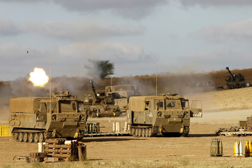 Click photo to download. Caption: The Israel Defense Forces Artillery Corps fires shells at Gaza on July 18, 2014, after Israeli forces began a ground invasion into northern Gaza amid Operation Protective Edge. Credit: Miriam Alster/Flash90.