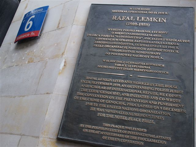 "Caption: A plaque on Kredytowa Street in Warsaw commemorating Raphael Lemkin, the Polish Jewish attorney and expert on the development of languages who coined the term ""genocide."" Credit: Wuj Mat via Wikimedia Commons."