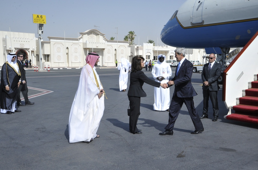 Click photo to download. Caption: U.S. Secretary of State John Kerry greets U.S. Ambassador to Qatar Susan Ziadeh upon his arrival in Doha, Qatar, on June 22, 2014. Qatar is a U.S. ally, but also funds the terrorist group Hamas. Credit: U.S. Department of State.