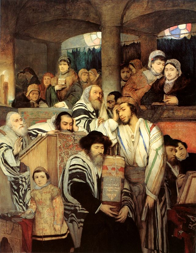 Click photo to download. Caption: A depiction of Jews praying in synagogue on Yom Kippur. Credit: Maurycy Gottlieb via Wikimedia Commons.