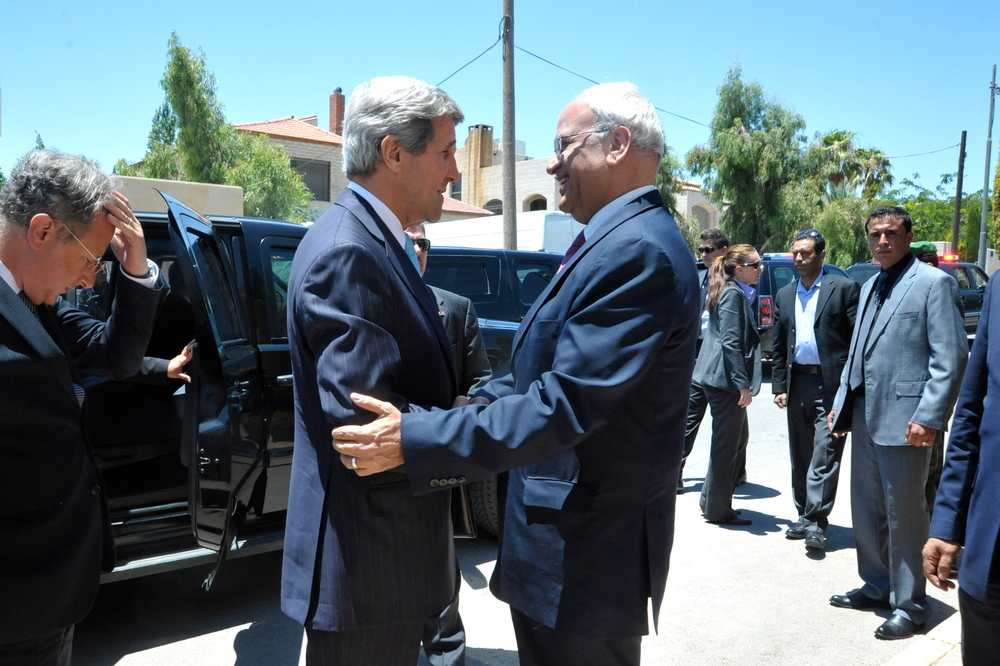 Click photo to download. Caption: U.S. Secretary of State John Kerry is greeted by Saeb Erekat, chief negotiator for the Palestinian Authority in the eventually collapsed American-brokered Israel-Palestinian peace talks, before a meeting in Amman, Jordan, on June 28, 2013.