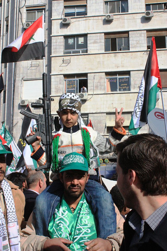A pro-Hamas rally in Damascus. Credit: Tasja via Wikimedia Commons.