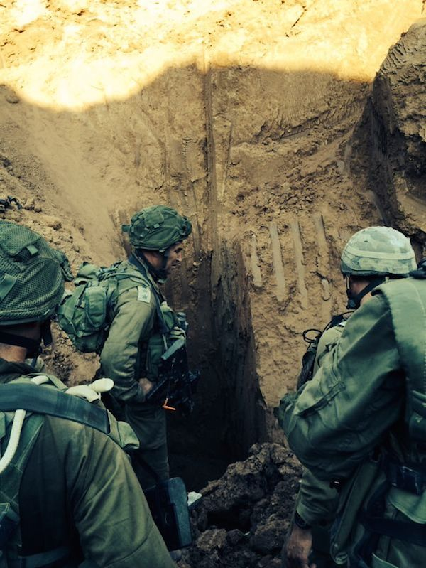 Click photo to download. Caption: During Operation Protective Edge, Israeli soldiers seen at the entrance to a Hamas terror tunnel found near the Erez border crossing into the Gaza Strip. Credit: IDF Spokesperson/Flash90.