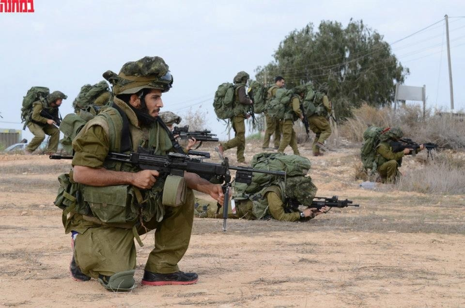 Click photo to download. Caption: Noad Lahat (front) serves for the Israel Defense Forces. Credit: Courtesy of UFC.