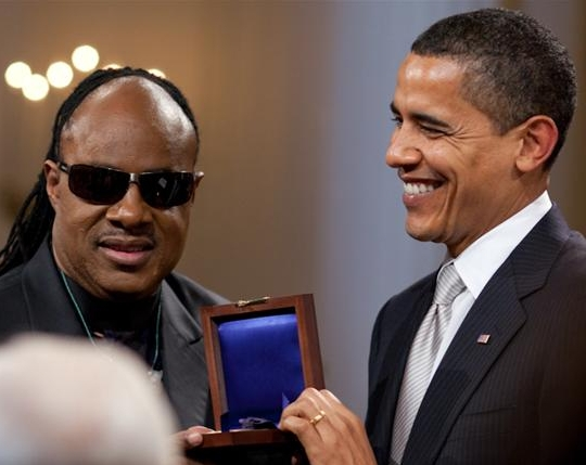 Click photo to download. Caption: President Barack Obama presents Stevie Wonder with the Gershwin Award for Lifetime Achievement in a celebration in the East Room of the White House. Credit: Pete Souza/White House.