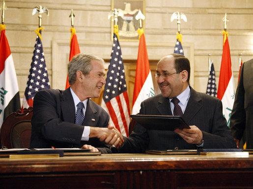 Former U.S. President George W. Bush with now-ousted Iraqi Prime Minister Nuri al-Maliki. Credit:White House photo by Eric Draper via Wikimedia Commons.