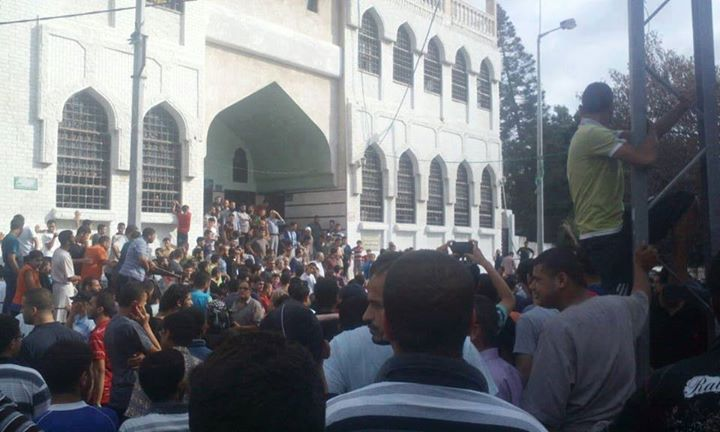 This photograph posted on a pro-Hamas Palestinian Facebook page shows a crowd outside of a Gaza mosque awaiting the executions of collaborators with Israel on Friday. Credit: Facebook.