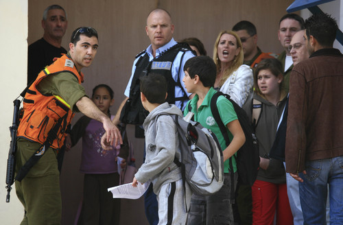 Click photo to download. Caption: Students are evacuated from a school in the southern Israeli city of Sderot in November 2009 after a Qassam rocket hit the building. Photo by Nati Shohat/Flash90.