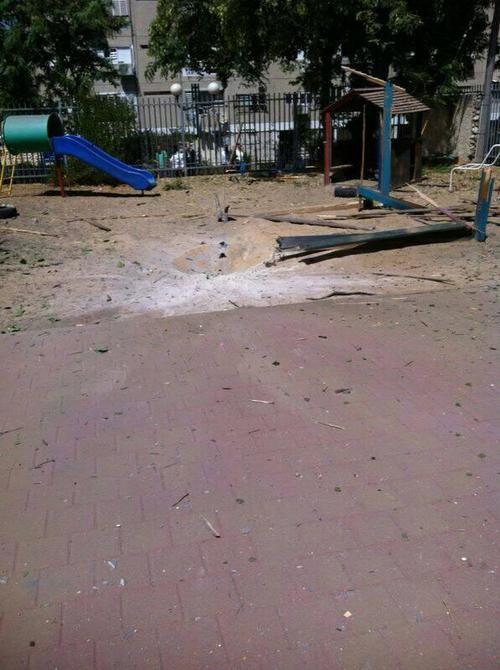 Rocket shrapnel fell in the pictured kindergarten courtyard in Ashdod on Tuesday. Credit: Twitter.