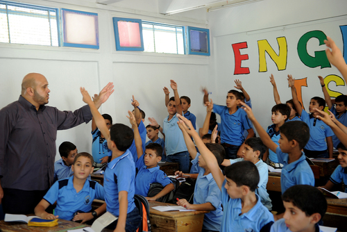 Click photo to download. Caption: Palestinian boys raise their hands during one of the first classes of the 2011-12 academic year at a school in Gaza supported by the United Nations Relief and Works Agency for Palestine Refugees in the Near East (UNRWA). Credit: UN Photo/Shareef Sarhan.