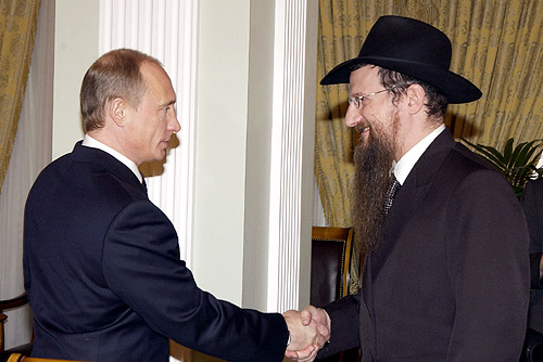 Russian President Vladimir Putin with Russia's chief Chabad rabbi, Berel Lazar. Credit: Wikimedia Commons.