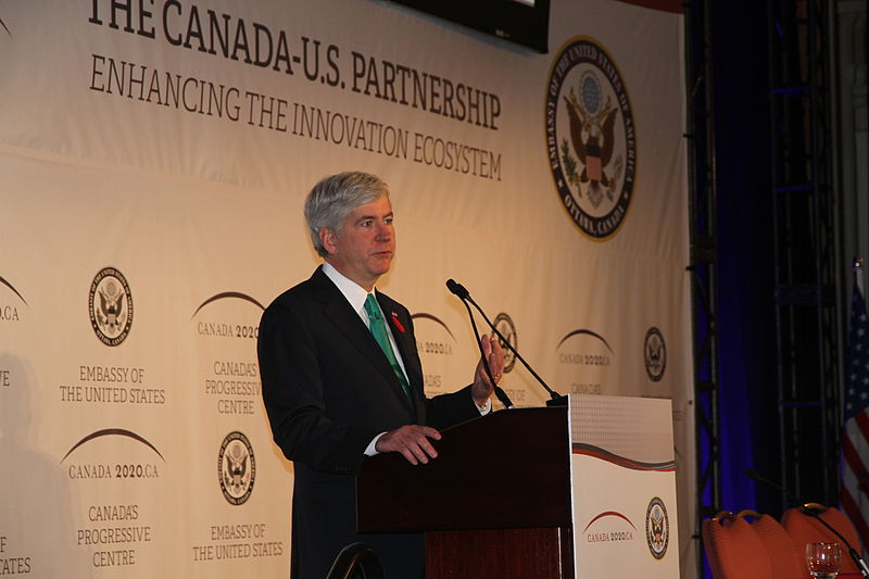 Click photo to download. Caption: On Labor Day weekend, Michigan Governor Rick Snyder (pictured) welcomed thousands of Muslims to Detroit for the annual convention of the Islamic Society of North America, where attendees heard from a disturbing lineup of radical Islamic speakers, reports Sarah N. Stern. Credit: US Mission Canada via Wikimedia Commons.