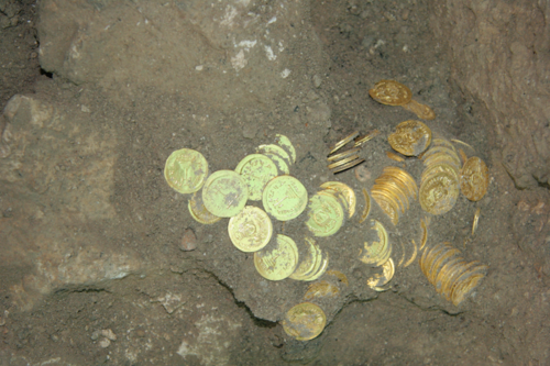 Click photo to download. Caption: The recent unearthing of the largest cache of gold coins ever discovered in Jerusalem, comprising 264 coins that date back to the end of the Byzantine period in the 7th century CE. Credit: City of David Foundation.