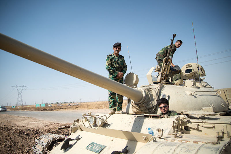 Click photo to download. Caption: Members of the Kurdish Peshmerga forces on a T-55 tank outside of Kirkuk in Iraq. Credit: Boris Niehaus via Wikimedia Commons.