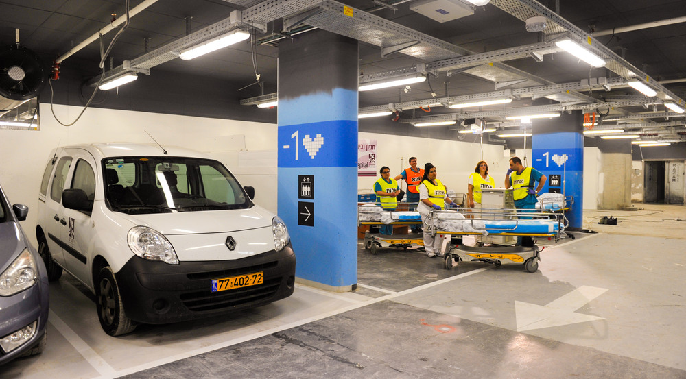 Click photo to download. Caption: The parking lot at the Rambam Health Care Campus that is a dual-purpose facility capable of converting into a fortified 2,000-bed underground hospital for times of conflict. Credit: Rambam Health Care Campus.