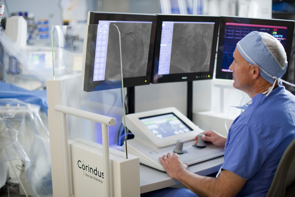 Click photo to download. The robotic catheterization system allows the doctor to open heart blockages and implant stents in patients remotely. Credit: Rambam Health Care Campus.