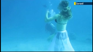 The Eilat underwater photo competition. Credit: Screenshot from a JewishNewsOne news report on the competition.