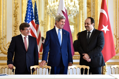 Click photo to download. Caption: On July 26, 2014, (from left to right) Turkish Foreign Minister Ahmet Davutoğlu, U.S. Secretary of State John Kerry, and Qatari Foreign Minister Khalid bin Mohammad Al Attiyah hold a trilateral meeting in Paris focused on reaching a cease-fire deal for the Gaza conflict. JNS.org columnist Ben Cohen asks: Should we continue ignoring Qatari and Turkish backing of Hamas for the sake of a successful campaign against Islamic State? Credit: State Department.
