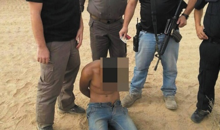 An armed Palestinian who was apprehended after infiltrating the Israel-Gaza border on Sunday. Credit: Courtesy of the Sdot Negev Regional Council.