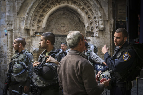 Click photo to download. Caption: Israeli Border Police officers guard the entrance for Palestinians to the Dome of the Rock and the Al-Aqsa mosque in Jerusalem's Old City on Monday, Oct. 13, 2014. Earlier that day, Palestinian rioting at Al-Aqsa forced Israeli security forces to limit the number of Palestinians allowed to enter the Temple Mount compound. Credit: Hadas Parush/Flash90.
