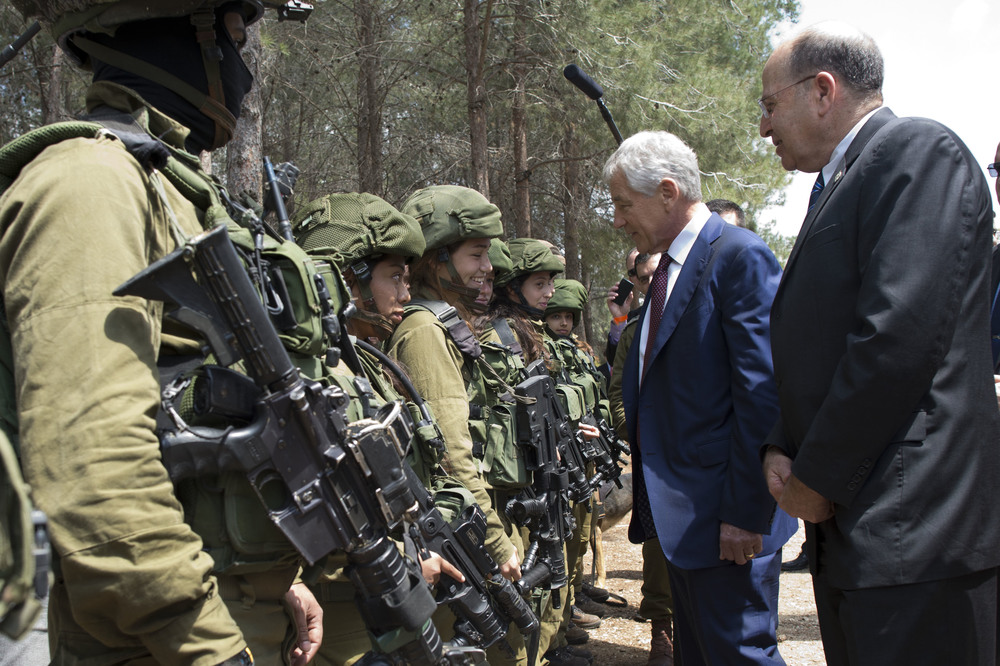 Click photo to download. Caption: U.S. Secretary of Defense Chuck Hagel and Israeli Minister of Defense Moshe Ya'alon (right) speak with members of the K-9 Special Forces Unit at Camp Adam in Israel on April 23, 2013. Credit: Secretary of Defense.