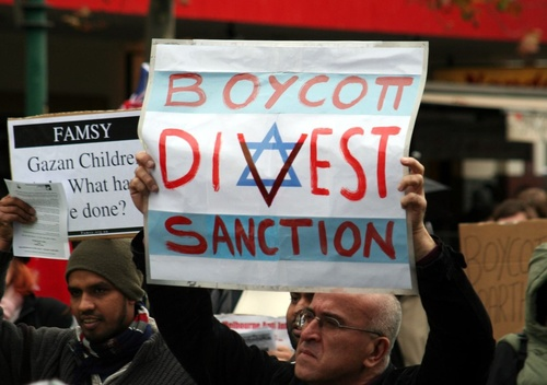 "Click photo to download. A Boycott, Divestment and Sanctions (BDS) protest against Israel in Melbourne, Australia, on June 5, 2010. The AMCHA initiative's recent posting of a list of 218 pro-BDS Middle Eastern studies professors drew criticism from a group of 40 Jewish studies who accused AMCHA of trying ""to stifle debate"" through its own boycott. AMCHA, however, claims it did not call for a boycott, but rather merely alerted students about potentially biased professors. Credit: Mohamed Ouda via  Wikimedia Commons."