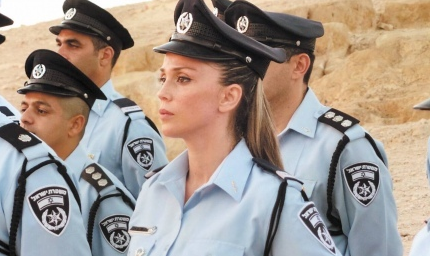 Fattan Nasser El-din (front), Israel's first female Druze police commander, during Tuesday's ceremony at Masada. C  redit: Israel Police/Hof District.