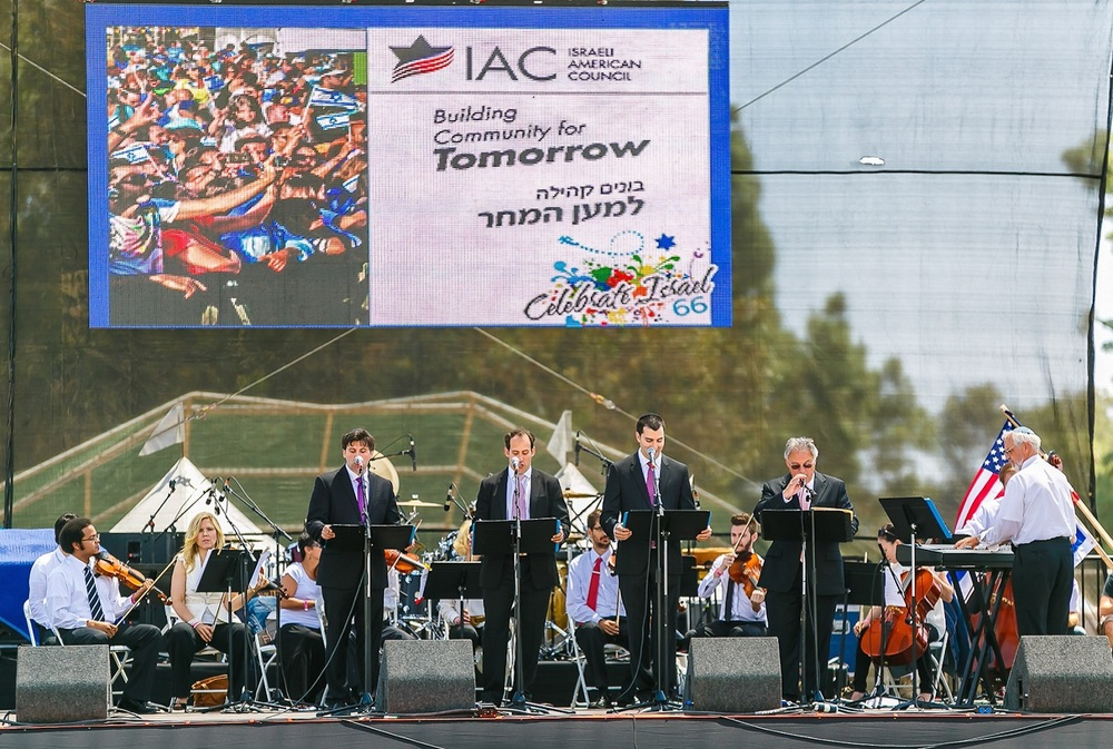 Click photo to download. Caption: From left to right, Cantor Nathanel Barham of Young Israel of North Beverly Hills, Cantor Sam Cohen of Temple Kehilat Maarav, Cantor Marcus Feldman of Sinai Temple, Cantor Nathan Lam of Stephen Wise Temple, and conductor Chris Harden of the Valley Beth Shalom synagogue perform at the Israel-American Council's Celebrate Israel Festival in Los Angeles on May 18, 2014. Credit: Abraham Joseph Pal.