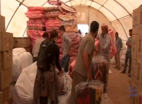 At a refugee camp, IsraAID delivers humanitarian aid to Iraq's beleaguered Christian and Yazidi populations. Credit: YouTube.