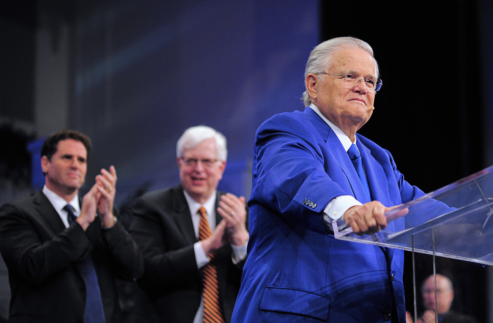 "Click photo to download. Caption: Christians United for Israel founder Pastor John Hagee addresses the 33rd annual ""A Night to Honor Israel"" in San Antonio on Sunday. Behind him are Israeli Ambassador to the U.S. Ron Dermer (left) and popular radio talk show host Dennis Prager, who both also spoke at the event. Credit: Paul Wharton Photography."