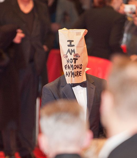 "Jewish actor Shia LaBeouf's claim that he has become Christian has been doubted given his record of pulling stunts, such as this appearance at the Berlinale International Film Festival's red carpet with a bag over his head with the writing ""I AM NOT FAMOUS ANYMORE."" Credit: Wikimedia Commons."