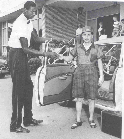 Click photo to download. Caption: National Basketball Association legend Wilt Chamberlain works as a bellhop at Kutsher's. Credit: Courtesy Mark Kutsher.