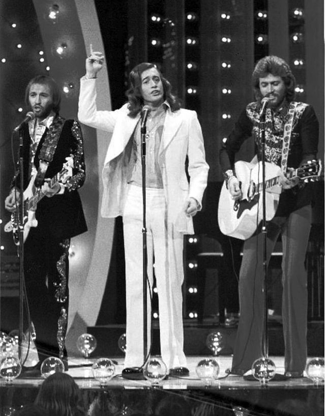 "Click photo to download. Caption: The Bee Gees perform on the ""Midnight Special"" television program in 1973. Credit: NBC Television - eBay via Wikimedia Commons."