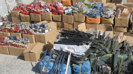 Police display the shipment of knives, stun guns, and fireworks—disguised as Christmas decorations—that was on its way to eastern Jerusalem. Credit: Israel Police Spokesperson's Unit.