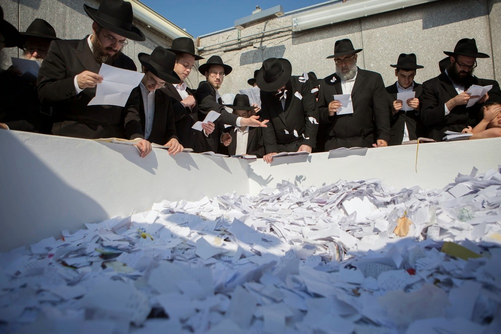 Click photo to download. Caption: Prayers at the gravesite of the seventh Chabad movement leader, Rabbi Menachem M. Schneerson, on the 20th anniversary of his passing on July 1, 2014 at Old Montefiore Cemetery in the Queens borough of New York City. Credit: Adam Ben Cohen/Chabad.org.