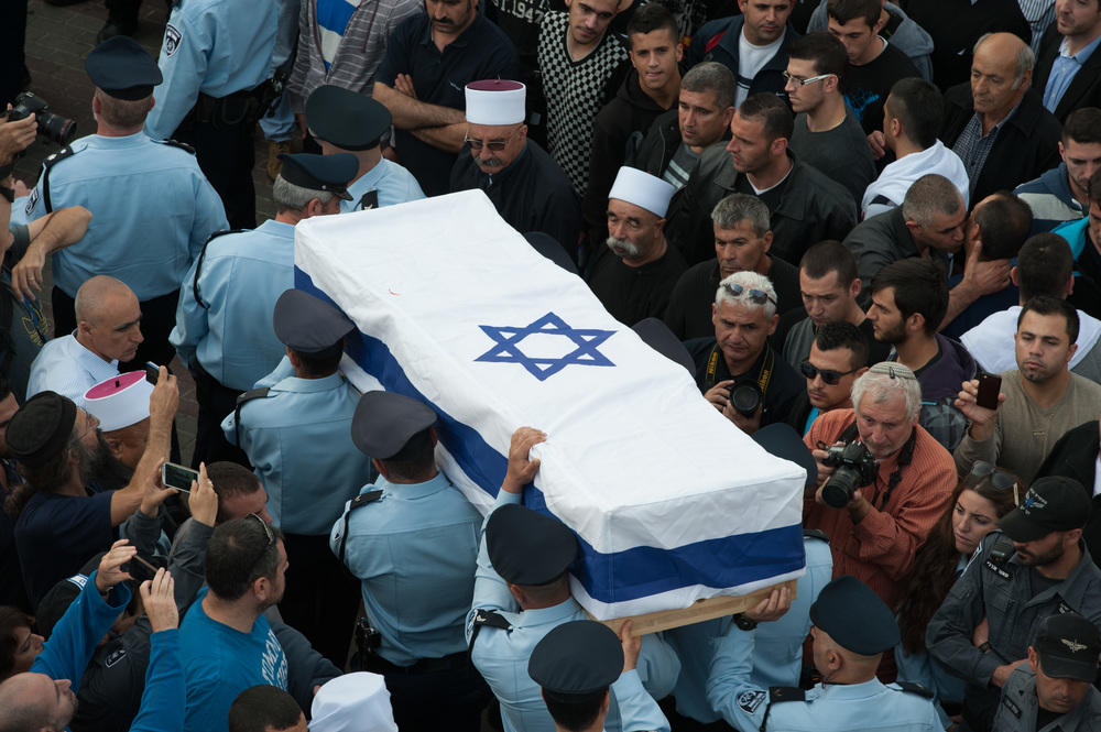 Click photo to download. Caption: Members of the Israeli police carry the coffin of Druze police officer Zidan Saif during his funeral in the northern village of Yanuh-Jat on Nov. 19. Saif was killed while trying to save Jewish worshippers from Palestinian terrorists who attacked a Jerusalem synagogue on Nov. 18. Credit: Flash90.