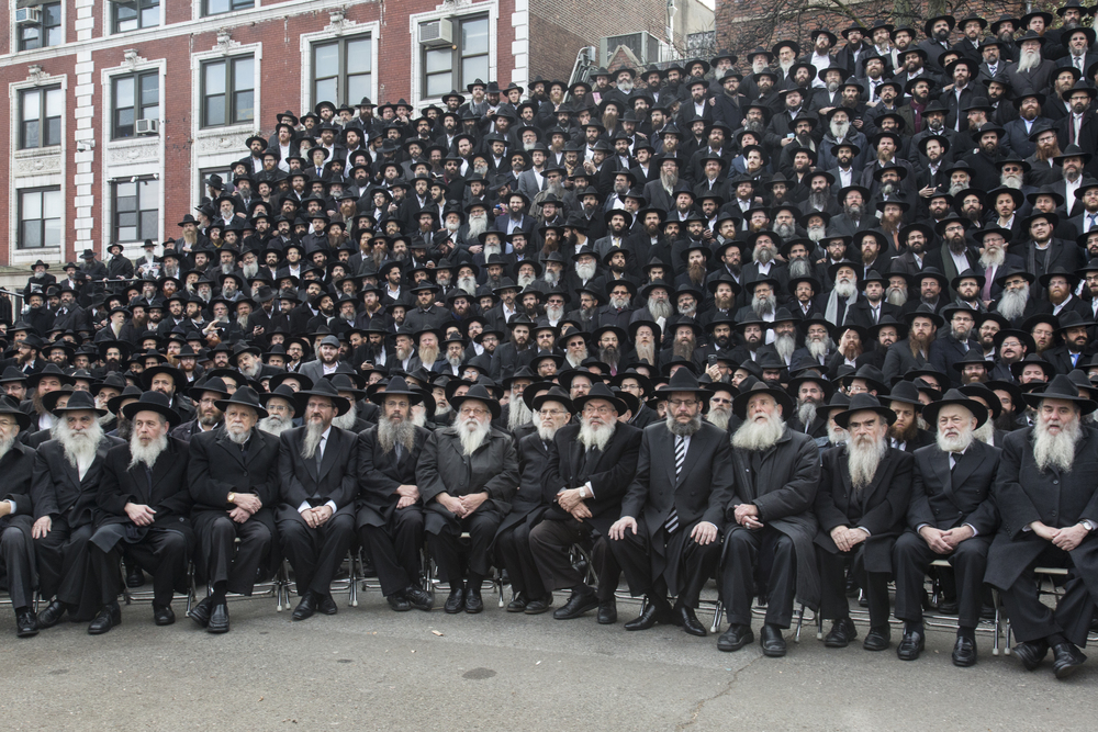 Click photo to download. Caption: Thousands of rabbis pose for a group photo in front of Chabad-Lubavitch headquarters in the Brooklyn borough of New York on Sunday, Nov. 23, 2014. The pictured rabbis were among the 4,200 rabbis from around the world who were in New York for the International Conference of Chabad-Lubavitch Emissaries.   Credit: Adam Ben Cohen/Chabad.org.