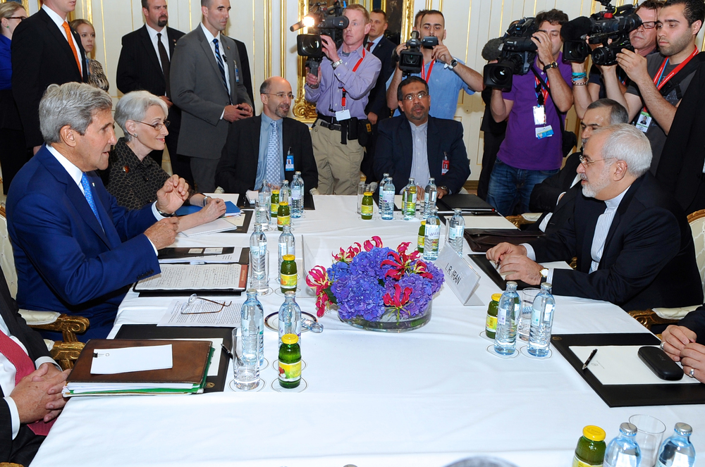 Click photo to download. Caption: U.S. Secretary of State John Kerry (in center, left side) prepares to sit down with Iranian Foreign Minister Mohammad Javad Zarif (in center, right side) in Vienna, Austria, on July 14, 2014, before they begin a bilateral meeting focused on Iran's nuclear program. Credit: State Department.