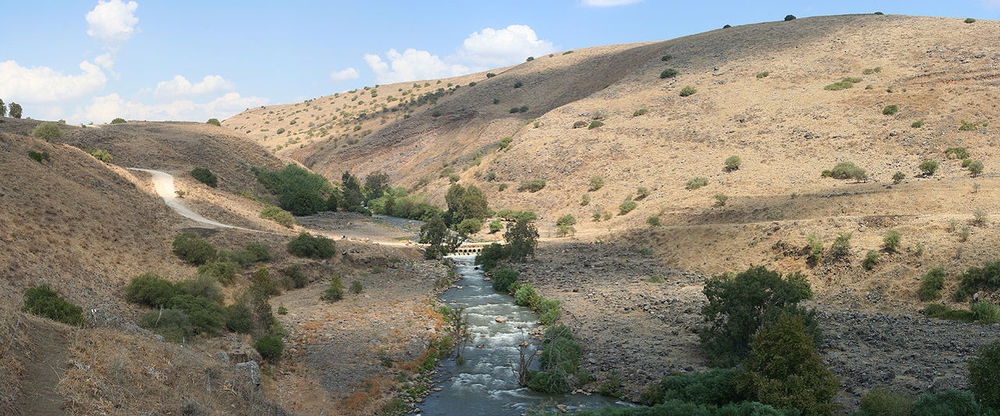 "Click photo to download. Caption: The Jordan River (pictured) is ""the only river on planet earth that on its good days is a few feet wide, and people claim that it has a bank 40 miles wide [spanning across Judea and Samaria],"" says Dani Dayan, chief foreign envoy of the Yesha Council. Credit: Beivushtang via Wikimedia Commons."