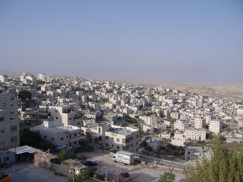 "Click photo to download. Caption: The eastern Jerusalem neighborhood of Issawiya. Media references to ""East Jerusalem"" with an uppercase ""E"" imply that the area is a different municipality than the undivided Israeli capital of Jerusalem. Credit: Faigl.ladislav via Wikimedia Commons."